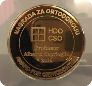 Medaglia d'oro al Merito Ortodontico - Spalato 2016 alberto Caprioglio dentista Pavia